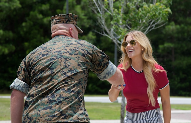 Lt. Col. Scott Meredith, commanding officer, Wounded Warrior Battalion-East, Marine Corps Base Camp Lejeune, welcomes Lindsay Ell, country music singer, songwriter and guitarist to WWBn-E on MCB Camp Lejeune, July 4. Ell received a tour of WWBn-E and saw the different types of therapy available to recovering service members, hours before her performance at Camp Lejeune's BaseFEST – an annual public Independence Day celebration hosted by the base. (U.S. Marine Corps photo by Cpl. Nikki L. Morales)