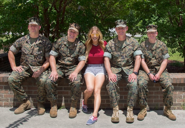 From left to right: Capt. Andrew Yeary, company commander, Headquarters Company, Wounded Warrior Battalion-East, Marine Corps Base Camp Lejeune; Maj. Joshua Ellsworth, executive officer, WWBn-E; Lindsay Ell, country music singer; Lt. Col. Scott Meredith, commanding officer, WWBn-E; Lt. Jonathan Jones, chaplain, WWBn-E, during Ell's tour of WWBn-E, July 4. Ell saw the different types of therapy available to recovering service members, hours before her performance at Camp Lejeune's BaseFEST – an annual public Independence Day celebration hosted by the base.  (U.S. Marine Corps photo by Cpl. Nikki L. Morales)