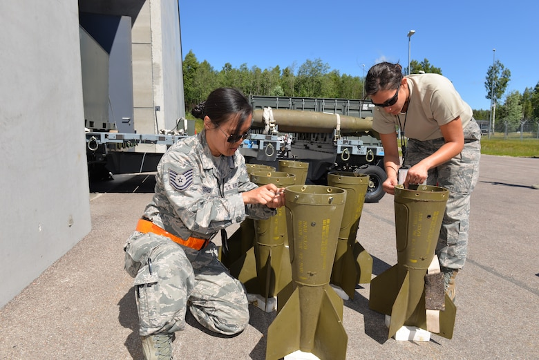U.S Air Force Tech. Sgt. Cinde Yoho, munitions controller and Staff. Sgt. Allna Decker, munitions accountability, both assigned to the 140th Wing Maintenance Group, Colorado Air National Guard, fix MK-82 500 pound bomb components, in support of the live ammunition drop during the Saber Strike 18, Amari Air Base, Estonia, June 4, 2018.