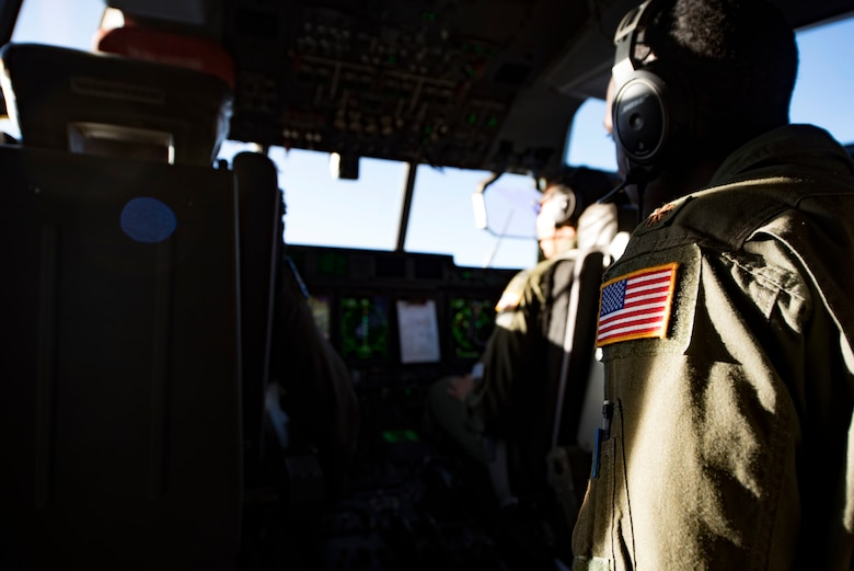 U.S. Air Force Maj. Willie Lloyd, 37th Airlift Squadron director of staff, oversees the manning of the lead C-130J Super Hercules during a training mission over Germany, on July 2, 2018. Once the pilots have led a formation long enough, they are recognized as multi-element flight lead qualified pilots. Multi-element flight lead qualified pilots help ensure the 37th Airlift Squadron is prepared to accomplish one of its primary missions: aerial delivery and mass on the drop-zone.