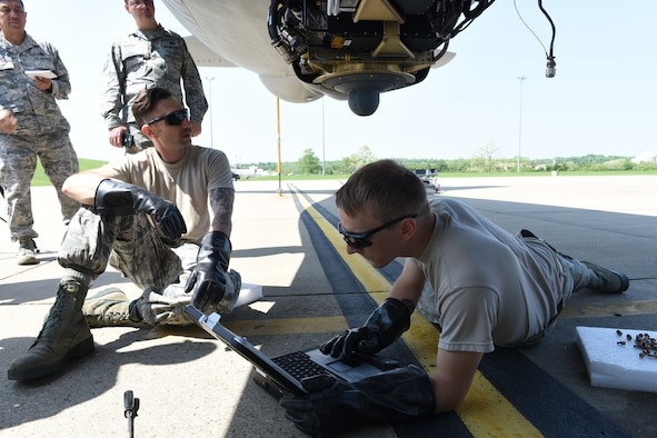 Senior Master Sgt. Joey Urena from the Air National Guard Test Center in Tucson, Ariz., and Master Sgt. Tony Burch from KC-135 System Program Office at Tinker Air Force Base, Okla., observe Pennsylvania Air National Guardsmen Master Sgt. Bryan Schulz and Tech. Sgt. Cameron of the 171st Air Refueling Wing perform maintenance on the Large Aircraft Infrared Counter-Measure third generation prototype system May 24, 2018 in Coraopolis, Pa. (U.S. Air National Guard Photo by Senior Airman Bryan Hoover)
