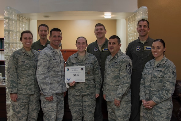 "Staff Sgt. Chelsea Duffy, 47th Flying Training Wing self-assessment program manager, was chosen by wing leadership to be the ""XLer"" of the week, for the week of June 25, 2018, at Laughlin Air Force Base, Texas. The ""XLer"" award, presented by Col. Charlie Velino, 47th Flying Training Wing commander, is given to those who consistently make outstanding contributions to their unit and the Laughlin mission. (U.S. Air Force photo by Airman 1st Class Daniel Hambor)"
