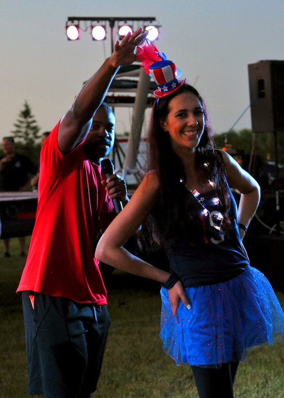 """""""Miss Independence"""", or Michelle Shepperd, strikes a pose after being crowned best adult costuem July 3, 2018, at Grand Forks Air Force Base, North Dakota. A child and adult costume contest were held during the base's Independence Day celebration known as Freedom Fest. (U.S. Air Force photo by Staff Sgt. Marcy Copeland)"""