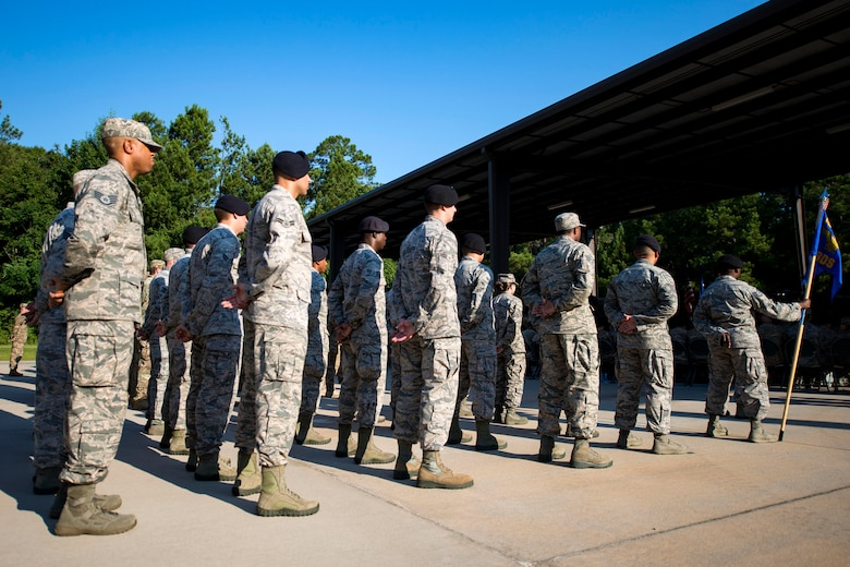 Airmen from the 820th Base Defense Group (BDG) stand at parade rest during a change of command ceremony, July 12, 2018, at Moody Air Force Base, Ga. The ceremony represents the formal passing of responsibility, authority and accountability of command from one officer to another. Col. Benito Barron, 820th BDG commander, who recently relinquished his duties as the Chief of the Homeland Defense and Protection Division for Headquarters United States Northern Command, will now command the 820th BDG. The 820th BDG is the Air Force's only unit specifically designed to provide fully integrated defense operations. (U.S. Air Force photo by Airman 1st Class Erick Requadt)