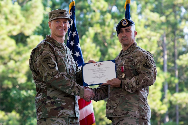 Col. Paul Birch, left, 93d Air Ground Operations Wing commander, and Col. Kevin Walker, 820th Base Defense Group (BDG) outgoing commander, pose for a photo during a change of command ceremony, July 12, 2018, at Moody Air Force Base, Ga. The ceremony represents the formal passing of responsibility, authority and accountability of command from one officer to another. Col. Benito Barron, 820th BDG commander, who recently relinquished his duties as the Chief of the Homeland Defense and Protection Division for Headquarters United States Northern Command, will now command the 820th BDG. The 820th BDG is the Air Force's only unit specifically designed to provide fully integrated defense operations. (U.S. Air Force photo by Airman 1st Class Erick Requadt)