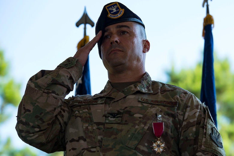 Col. Kevin Walker, 820th Base Defense Group (BDG) outgoing commander, renders his final salute to the 820th BDG during a change of command ceremony, July 12, 2018, at Moody Air Force Base, Ga. Col. Benito Barron, 820th BDG commander, who recently relinquished his duties as the Chief of the Homeland Defense and Protection Division for Headquarters United States Northern Command, will now command the 820th BDG. The ceremony represents the formal passing of responsibility, authority and accountability of command from one officer to another. The 820th BDG is the Air Force's only unit specifically designed to provide fully integrated defense operations. (U.S. Air Force photo by Airman 1st Class Erick Requadt)
