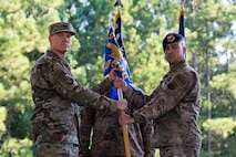 Col. Paul Birch, left, 93d Air Ground Operations Wing commander, and Col. Kevin Walker, 820th Base Defense Group (BDG) outgoing commander, pose for a photo during at change of command ceremony, July 12, 2018, a Moody Air Force Base, Ga. The ceremony represents the formal passing of responsibility, authority and accountability of command from one officer to another. Col. Benito Barron, 820th BDG commander, who recently relinquished his duties as the Chief of the Homeland Defense and Protection Division for Headquarters United States Northern Command, will now command the 820th BDG. The 820th BDG is the Air Force's only unit specifically designed to provide fully integrated defense operations. (U.S. Air Force photo by Airman 1st Class Erick Requadt)