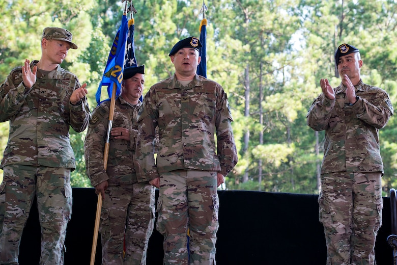 Leadership from the 93d Air Ground Operations Wing congratulates Col. Benito Barron, 820th Base Defense Group (BDG) commander, after he assumes command of the 820th BDG during a change of command ceremony, July 12, 2018, at Moody Air Force Base, Ga. The ceremony represents the formal passing of responsibility, authority and accountability of command from one officer to another. Barron, who recently relinquished his duties as the Chief of the Homeland Defense and Protection Division for Headquarters United States Northern Command, will now command the 820th BDG. The 820th BDG is the Air Force's only unit specifically designed to provide fully integrated defense operations. (U.S. Air Force photo by Airman 1st Class Erick Requadt)