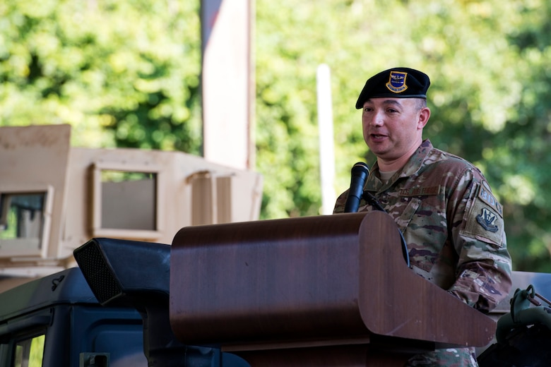 Col. Benito Barron, 820th Base Defense Group (BDG) commander, gives remarks during a change of command ceremony, July 12, 2018, at Moody Air Force Base, Ga. The ceremony represents the formal passing of responsibility, authority and accountability of command from one officer to another. Barron, who recently relinquished his duties as the Chief of the Homeland Defense and Protection Division for Headquarters United States Northern Command, will now command the 820th BDG. The 820th BDG is the Air Force's only unit specifically designed to provide fully integrated defense operations. (U.S. Air Force photo by Airman 1st Class Erick Requadt)