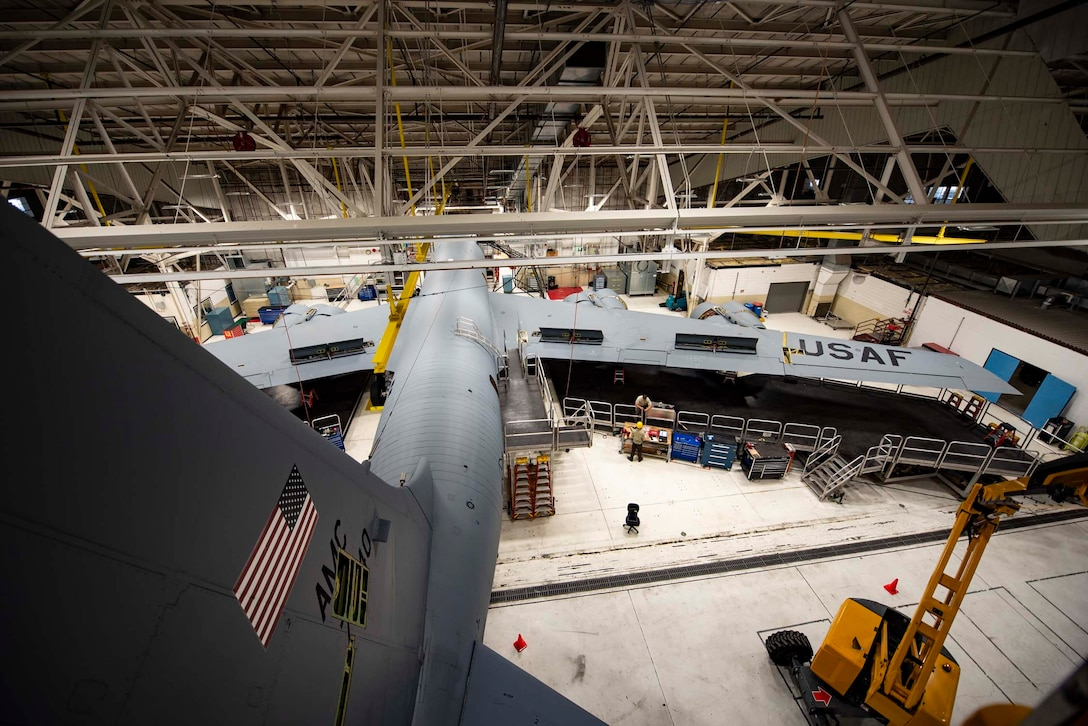 A KC-135 sits in the sustainment dock hangar while maintainers from the 141st and 92nd Maintenance Squadrons work during an isochronal inspection June 5, 2018 at Fairchild Air Force Base, Wash. Airmen from 11 different specialties complete the process of dismantling, inspecting, repairing and sometimes modifying the aircraft during the isochronal inspection. (U.S. Air National Guard photo by Tech. Sgt. Kayleigh Phillips)