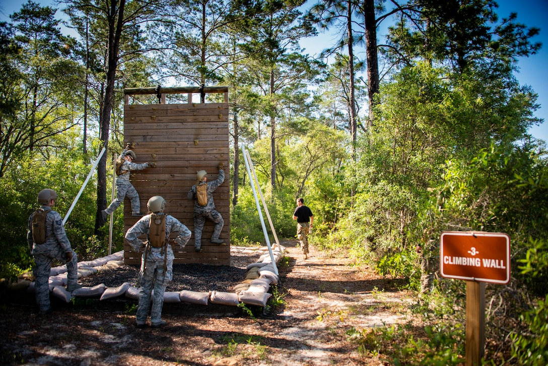 Airmen from the 919th Special Operations Security Forces Squadron begin scaling the climbing wall obstacle at a course May 5, 2018 on Eglin Air Force Base, Fla.