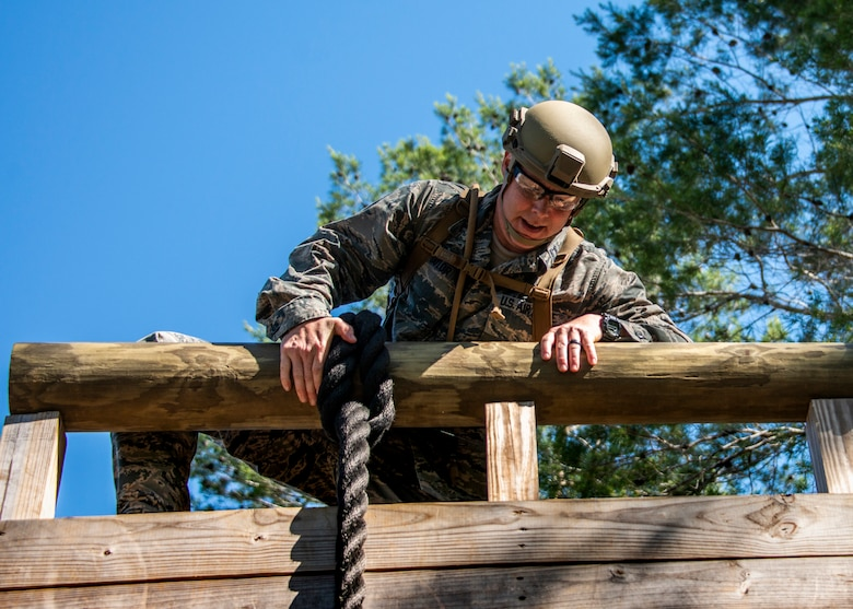 Capt. Samuel Taylor, 919th Special Operations Security Forces Squadron commander, prepares to surmount a rope wall obstacle at a course May 5, 2018 on Eglin Air Force Base, Fla.