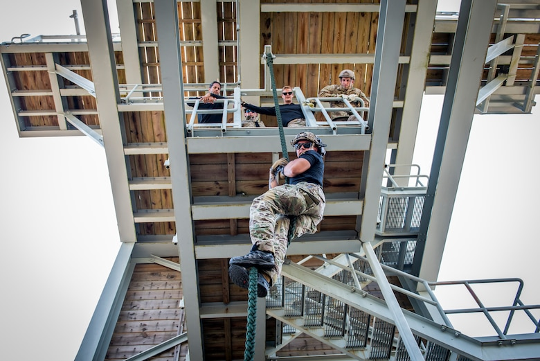 Staff Sgt. Jovani Santos Hernandez, a 919th Special Operations Security Forces Squadron training cadre member, demonstrates proper techniques for fast roping from a tower on Eglin Air Force Base, Fla.
