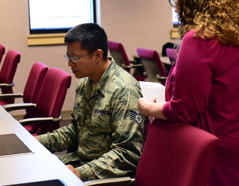 U.S. Air Force Staff Sgt. Alan Lin, a flight kitchen manager assigned to the 509th Force Support Squadron, listens to test instructions before taking the Defense Language Proficiency Test for Mandarin Chinese at Whiteman Air Force Base, Missouri, June 19, 2018. All ranks from all military branches and civilians may take the DLPT, which offers tests for more than 60 languages.