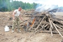 Tech. Sgt. Sean Sullivan, 445th Civil Engineer Squadron firefighter, burns brush cleared from a 40-acre area at Camp Kamasa, Crystal Springs, Mississippi, June 6, 2018.