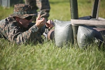 Sgt. Derek Ford fastens a piece of equipment in place during a tool familiarization range aboard MCAS Beaufort July 11. This type of training is conducted regularly to ensure that each Marine is proficient and ready to use the equipment correctly. Ford is an Explosive Ordnance Disposal Marine with Marine Wing Support Detachment 31.