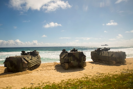 U.S. Marines with AAVs splash in RIMPAC during RIMPAC