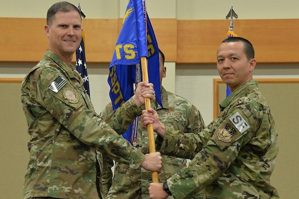 Maj. Tito Ruiz, right, accepts command of the 1341st Security Support Squadron from Col. Aaron Guill, 341st Security Forces Group commander during a change of command ceremony July 12, 2018, at the Grizzly Bend on Malmstrom AFB, Mont.