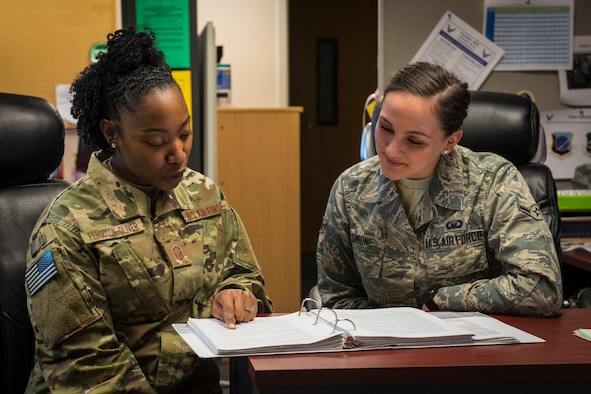 U.S. Air Force Master Sgt. Samantha Ferguson-Oliver, 92 Air Refueling Wing Religious Affairs superintendent, mentors Airman Olivia Simione, 92nd ARW Religious Affairs apprentice at Fairchild Air Force Base, Washington, July 2, 2018. Religious Affairs Airmen and Chaplains continuously develop and grow their skills to offer quality support to Airmen and their families. (U.S. Air Force photo/Airman 1st Class Whitney Laine)