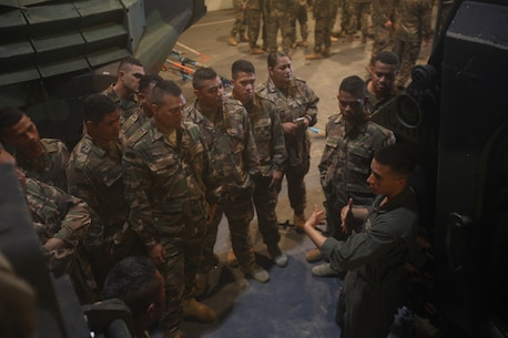 Tongan Marines get familiar with AAVs aboard HMAS Adelaide during RIMPAC