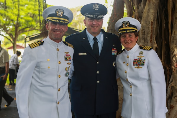 The official party awaits the DLA Pacific Change of Command ceremony. From left: Navy Capt. Timothy Daniels, outgoing DLA Pacific Commander; Air Force Maj. Gen. Mark Johnson, director of DLA Logistics Operations; and Navy Capt. Kristin Acquavella, incoming DLA Pacific commander. (Photo by Marine Cpl. Patrick Mahoney)