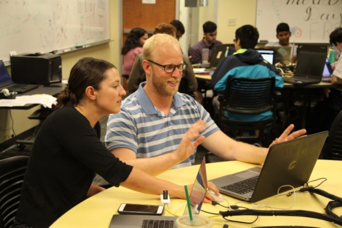 AFRL researchers Dr. Theresa Scarnati and Dr. Chris Paulson at a Wright State University workplace for summer interns with the Autonomous Technology Research Center. (Courtesy photo)