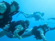 U.S. Marines with Maritime Raid Force, 26th Marine Expeditionary Unit, swim underwater during dive training in Aqaba, Jordan, July 8, 2018. Iwo Jima is deployed to the U.S. 5th Fleet area of operations in support of naval operations to ensure maritime stability and security in the central region, connecting the Mediterranean and the Pacific through the western Indian Ocean and three strategic choke points.