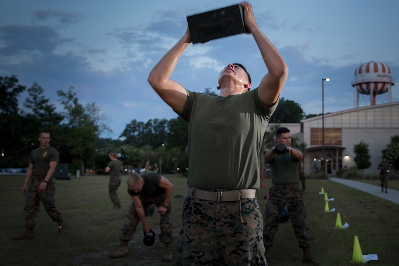 Marines exercise during a High Intensity Tactical Training session led by Force Fitness instructor, Sgt. Jared Skelley, July 12 aboard Marine Corps Air Station Beaufort. Skelley specializes in creating workout routines for individual Marines focusing on functional planes of motion, combat readiness and injury prevention.
