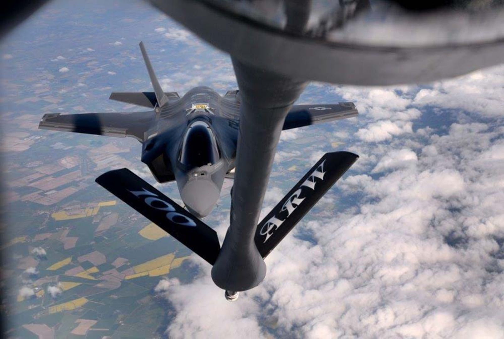 An inflight refueling is depicted.