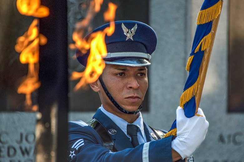 Senior Airman Teddy Ramos, base honor guardsman, presents the Air Force colors during the singing of the national anthem June 25, 2018, at Eglin Air Force Base, Fla. (U.S. Air Force photo by Staff Sgt. Peter Thompson)