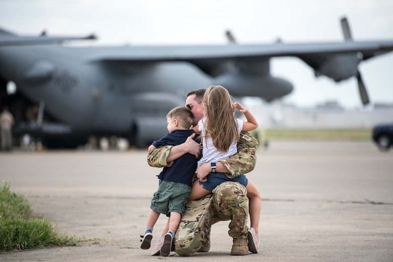 More than 60 members of the Kentucky Air National Guard's 123rd Airlift Wing are reunited with friends and family as they return to their home base in Louisville, Ky., July 6, 2018, after completing a four-month deployment to the Persian Gulf region in support of Operation Inherent Resolve. (U.S. Air National Guard photo by Master Sgt. Phil Speck)