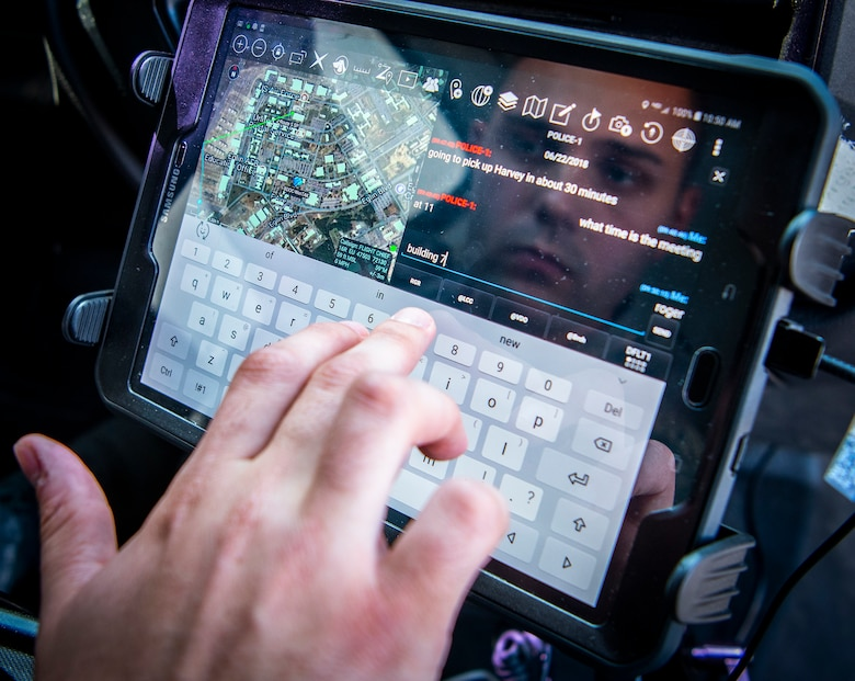A 96th Security Forces Squadron Airman uses the android tactical assault kit to send a message from his patrol vehicle July 5, 2018, at Eglin Air Force Base, Fla. (U.S. Air Force photo by Samuel King Jr.)