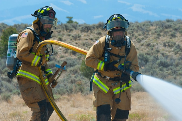 The 1157th Engineer Company (firefighters) from the Colorado National Guard conduct a training exercise to prepare for any real-world incident at the Spring Creek Fire helipad in Fort Garland, Colo., July 6, 2018.