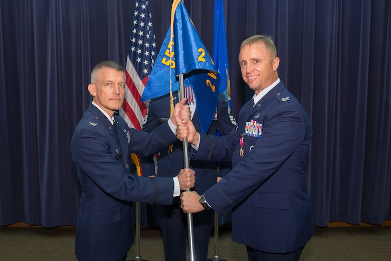 U.S. Air Force Col. Jason Patla, 2nd Weather Group (WXG) commander, relinquishes command of the 2nd WXG to U.S. Air Force Col. Brian Pukall, 557th Weather Wing commander, during a change of command ceremony July 11, 2018, at Offutt Air Force Base, Nebraska. Patla will go on to command Air Force Reserve Officer Training Corps Detachment 157 in Daytona Beach, Florida. (U.S. Air Force photo by Paul Shirk)