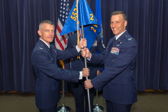 U.S. Air Force Col. Patrick Williams, 2nd Weather Group (WXG) commander, assumes command of the 2nd WXG from U.S. Air Force Col. Brian Pukall, 557th Weather Wing commander, July 11, 2018, at Offutt Air Force Base, Nebraska. 2nd WXG provides global, terrestrial, space and climatological environmental intelligence to the joint force, defense agencies, Department of Defense senior leaders, select members of the intelligence community, interagency partners and allied nations. (U.S. Air Force photo by Paul Shirk)