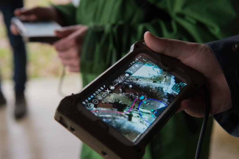 A man holds an electronic tablet.