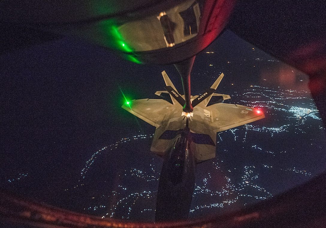 A U.S. Air Force F-22 Raptor receives in-flight fuel from a KC-135 Stratotanker assigned to the 28th Expeditionary Air Refueling Squadron during an aerial refueling mission in support of Operation Inherent Resolve over Iraq, July 6, 2018. The F-22 is designed to project air dominance, rapidly and at great distances and defeat threats attempting to deny access to our nation's Air Force, Army, Navy and Marine Corps. (U.S. Air Force photo by Staff Sgt. Keith James)