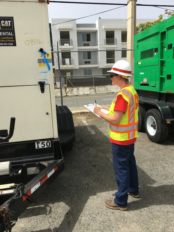 A member of the Pittsburgh District temp power team validates inventory returned to the Federal Emergency Management Agency (FEMA) for on island storage.