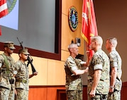"Sergeant Major William T. Thurber, U.S. Marine Corps Forces Central Command sergeant major, presents the MARCENT battle colors to Lt. Gen. Dave ""Smoke"" Beydler during a change of command ceremony at the Vince Tolbert Building at MacDill Air Force Base, July 11. Beydler, who has served as the MARCENT commander since Oct. 27, 2015, will pass the battle colors to Lt. Gen. Carl E. Mundy, III, representing the exchange of command."