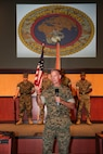 Lieutenant General Carl E. Mundy, III, the new commander of United States Marine Corps Forces, Central Command addresses the service members and attendees during the MARCENT change of command ceremony, at the Vince Tolbert Building at MacDill Air Force Base, July 11. Mundy assumed command from Lt. Gen. William D. Beydler, who has served as the MARCENT Commander since Oct. 27, 2015.
