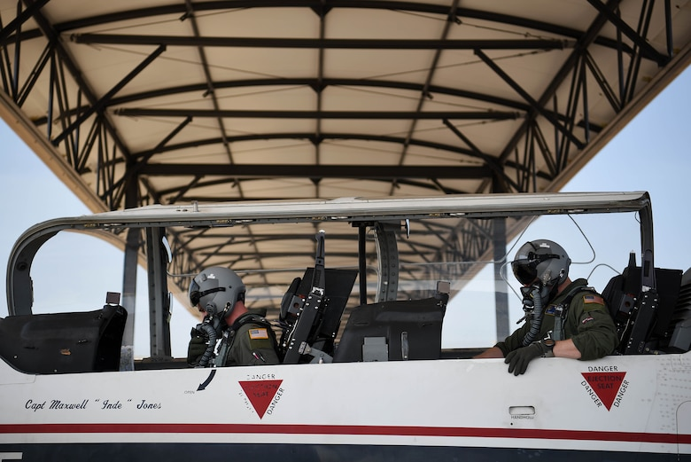 Second Lt. Cameron Duley, 41st Flying Training Squadron student pilot, and Capt. Conor Murphy, 41st FTS instructor pilot, prepare for a sortie July 2, 2018, on Columbus Air Force Base, Mississippi. A T-6 Texan II training mission starting from the mission brief to debrief can take hours and instructor pilots can do up to three flights in one day. (U.S. Air Force photo by Airman 1st Class Keith Holcomb)