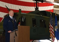 Lieutenant Colonel Adam Rudolphi, 37th Helicopter Squadron commander, speaks to the crowd attending the 37th HS Change of Command July 13, 2018, in Building 1250 on F.E. Warren Air Force Base, Wyo. The ceremony signified the transition of command from Lt. Col. James Cline to Rudolphi. (U.S. Air Force photo by Glenn S. Robertson)