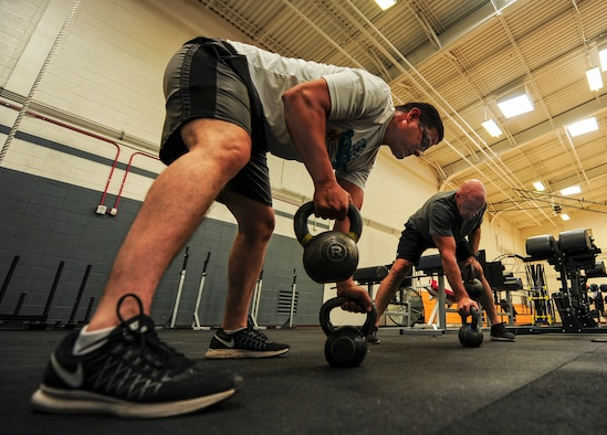 Desert Lightning Team members perform kettle bell rows during the Advanced Physical Therapy Class at Davis-Monthan Air Force Base, Ariz., May 30, 2018. The Advanced Physical Therapy Class is held at D-M AFB three times a week and introduces patients to joint-safe exercises that are intended to prevent future injuries. (U.S. Air Force photo by Airman 1st Class Frankie D. Moore)