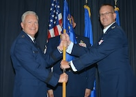 Col. Timothy Sejba receives the Advanced Systems & Development Directorate guidon during a change of command ceremony July 13 here, as Lt. Gen. John Thompson, commander of the Space and Missile Systems Center, Los Angeles Air Force Base, Calif. The directorate and its parent SMC are both under Air Force Space Command. (U.S. Air Force photo by Todd Berenger)