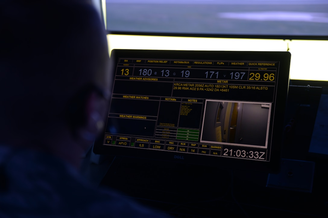 Senior Airman Joel Williams III, a 28th Operations Support Squadron air traffic control journeyman, monitors at the entrance screen inside the air traffic control tower at Ellsworth Air Force Base, S.D., July 10, 2018. Air traffic controllers at Ellsworth AFB work two different shifts at the tower: one morning shift and one swing shift in the afternoon. (U.S. Air Force photo by Airman 1st Class Nicolas Z. Erwin)