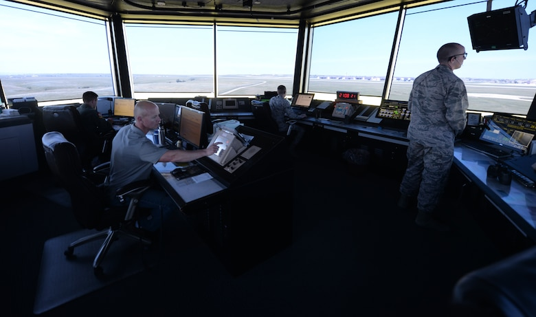 The 28th Operations Support Squadron air traffic control tower's swing shift team works to coordinate safe travel on the flight line at Ellsworth Air Force Base, S.D., July 10, 2018. Air traffic controllers are qualified to work on both the tower, which coordinates movement on the flight line, and the radar approach control team, which coordinates aircraft movement in the sky. (U.S. Air Force photo by Airman 1st Class Nicolas Z. Erwin)