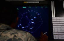 Staff Sgt. Anthony Morgan, the 28th Operations Support Squadron air traffic control standardization and evaluation noncommissioned officer in charge, coordinates flights at a radar approach control terminal at Ellsworth Air Force Base, S.D., July 10, 2018. Air traffic controllers at Ellsworth AFB are qualified on not only their own flight line, but also on the flight line at Minot AFB, North Dakota. (U.S. Air Force photo by Airman 1st Class Nicolas Z. Erwin)