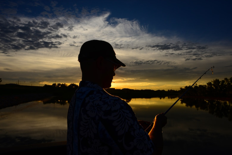 Airman John Ennis, a 28th Bomb Wing Public Affairs broadcast journalist, prepares to cast his fishing rod at Gateway Lake on Ellsworth Air Force Base, S.D., July 12, 2018. Caution is advised as snapping turtles have been seen in lakes located across the base. (U.S. Air Force photo by Airman 1st Class Nicolas Z. Erwin)