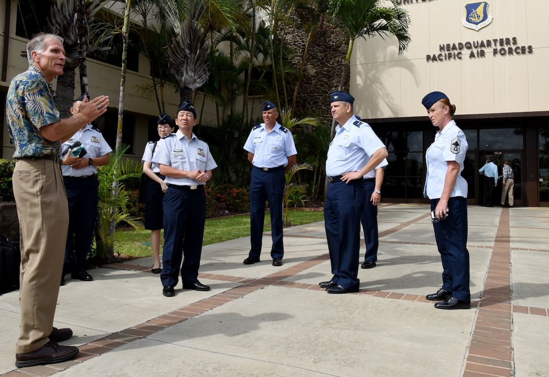 Charles Nicholls, U.S. Pacific Air Forces (PACAF) historian, gives Koukuu Jieitai, Japan Air Self Defense Force, Maj. Gen. Shinya Bekku, Koku Jieitai Surgeon General, a tour of the PACAF Headquarters building at Joint Base Pearl Harbor-Hickam, Hawaii, July 11, 2018.