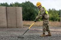 Pfc. Travis Kearns, a signal support system specialist in the West Virginia Army National Guard, assigned to 812th Engineer Company, 1092nd Engineer Battalion, 111th Engineer Brigade, based out of Eleanor, West Virginia, uses a rake to level out the recently placed gravel while at Drawsko Pomorskie Training Area, Poland, during Resolute Castle, July 12, 2018. Resolute Castle is a multinational training exercise for NATO and U.S. Army engineers, which supports Atlantic Resolve by promoting interoperability. Atlantic Resolve is a demonstration of the United States' commitment to the collective security of Europe through the deployment of rotational U.S. forces in cooperation with NATO ally and partner nations.